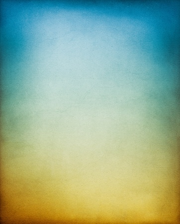 background texture: A vintage, textured paper background with an earth to sky toned gradient. Stock Photo