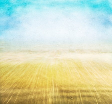 A vintage coastal seascape with background fog and sky, and blurred water motion with a textured paper overlay.  Image displays a pleasing paper grain and fibers at 100%. Stock Photo - 9815208