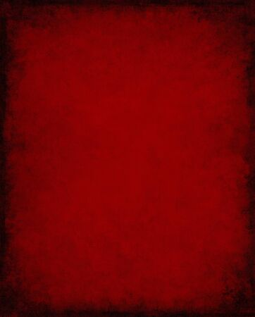 An old, vintage red paper background with dark grunge patterns and  vignette. Stock Photo