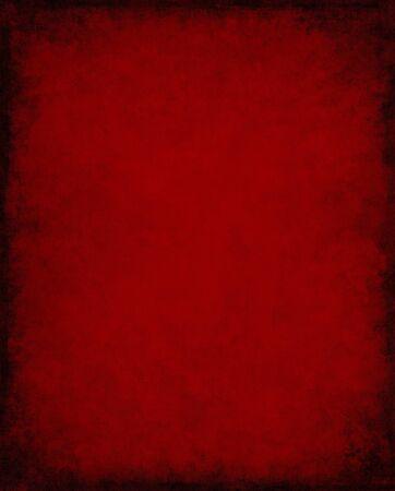 An old, vintage red paper background with dark grunge patterns and  vignette. Banque d'images