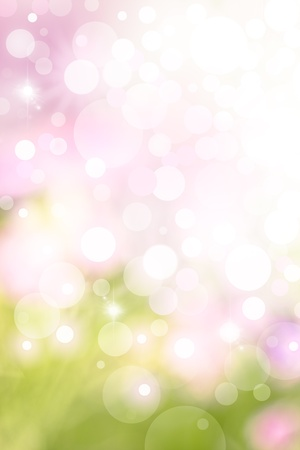 A bright spring background with green and pink bokeh effects. photo