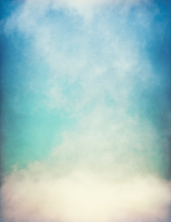 cloudscapes: Fog and clouds on a vintage, textured paper background with a color gradient.