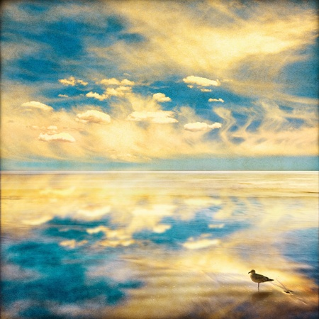A fantasy sky and clouds seascape with a dreamy vintage look.  Image displays a pleasing paper grain and fiber texture at 100%. photo
