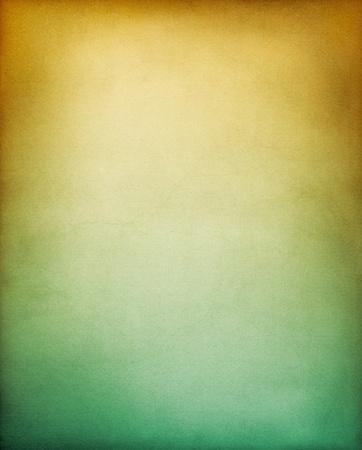Een uitstekende getextureerd papier achtergrond met een geel tot groen gradatie.