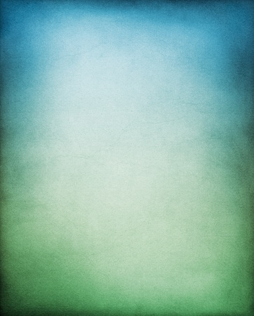 distressed texture: A textured paper backgrouund with a green to blue gradation. Stock Photo