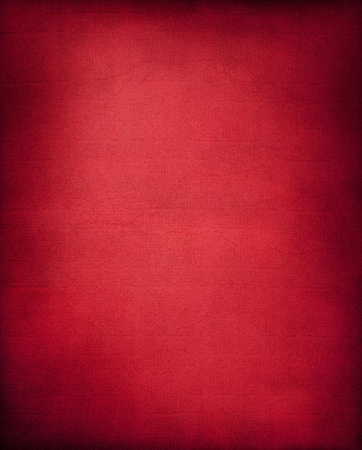 fabric texture: A textured red background with a subtle screen pattern. Stock Photo