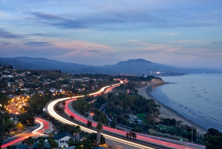 An overview of the 101 freeway at dusk looking east from Santa Barbara, California.