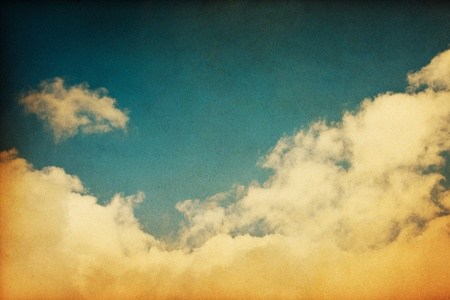A retro cloudscape with vintage colors and a textured paper background. Stock Photo - 10089720