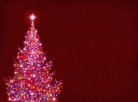A bright and colorful Christmas tree on a textured red background. Фото со стока