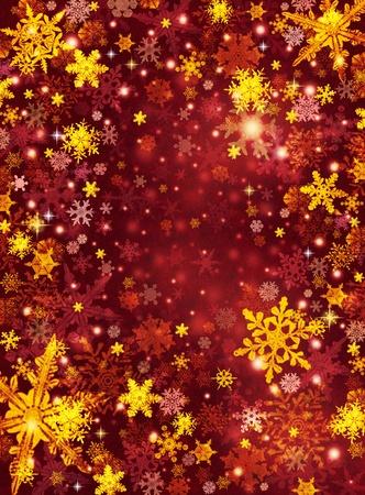 暗い用紙の背景の金と赤の雪片。