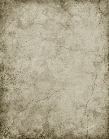 Old textured paper with cracks and stains in a neutral gray. photo