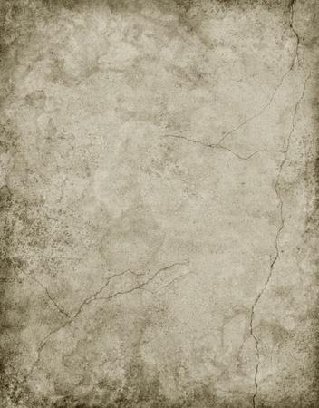 fissure: Vieux papiers textur�s avec les fissures et les taches � un gris neutre.