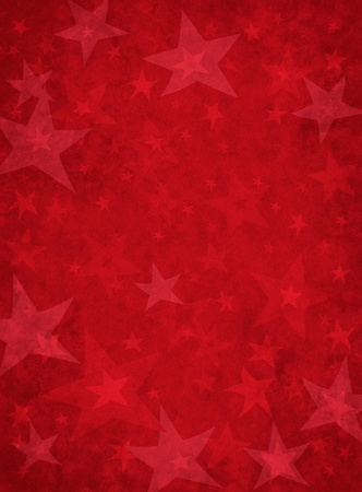 Grungy star shapes on a textured paper background. photo