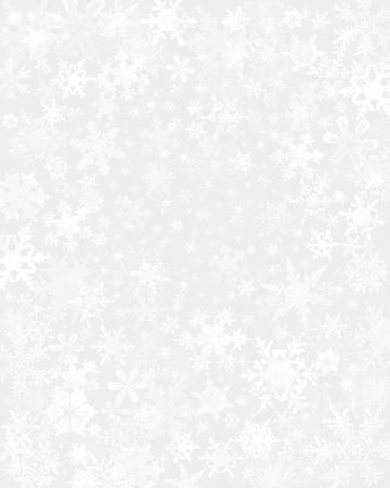 薄い灰色の背景の微妙な雪フレーク。