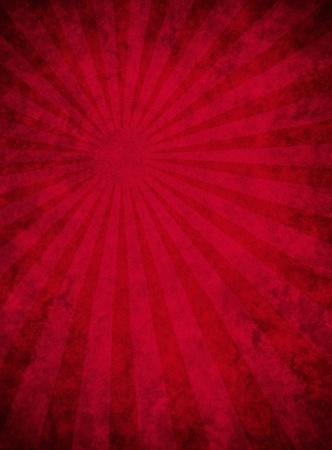 グランジのまだらにされたパターンと暗赤色の紙の背景と微妙な光ビームの効果を実行します。 写真素材