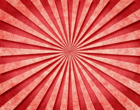 radial: A red sunbeam pattern on vintage paper with a 3-D look.