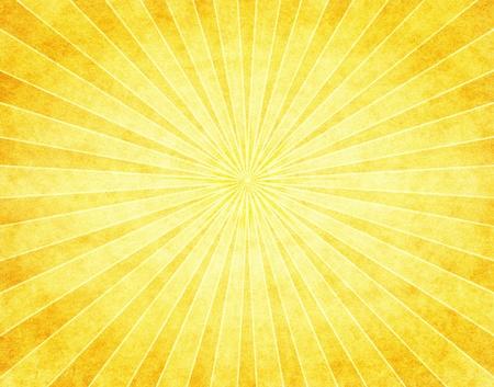 radiating: Un modello luminoso raggio di sole giallo su carta vintage.