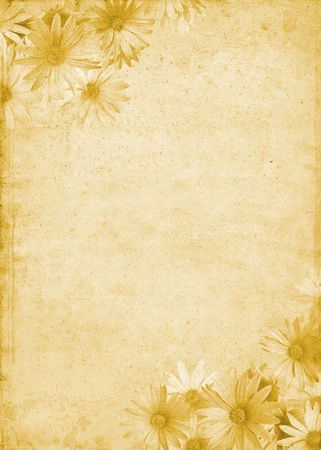 Flowers on a background of aged and mottled paper.