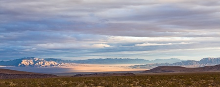 A panoramic view of the Mojave desert at sunset.