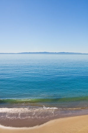 The Santa Barbara channel along Butterfly Beach with Santa Cruz Island in the background. Stock Photo - 10264999