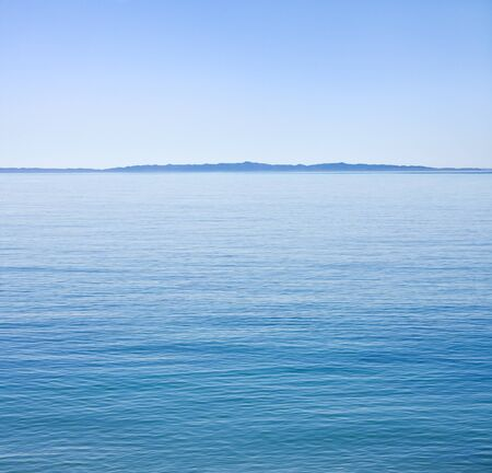unusually: The Santa Barbara channel on an unusually calm day with Santa Cruz Island in the background. Stock Photo