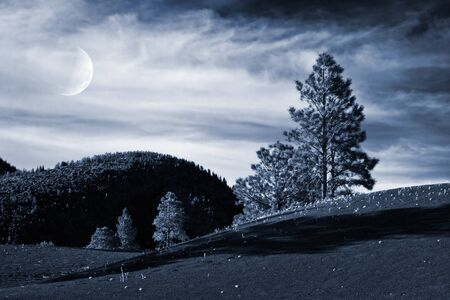 A toned alpine landscape rendered as a night image. photo