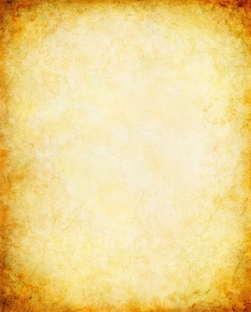An vintage paper background with a glowing center and vignette. photo
