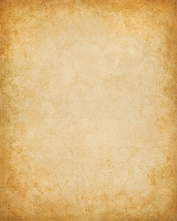 beige: Old paper with stains and a vignette effect. Stock Photo