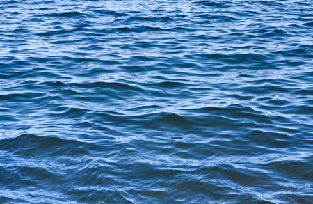 A background of ocean waves and ripples off the California coast.  Stock Photo