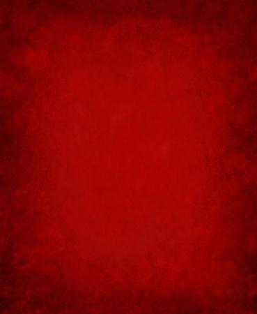 full red: Uno sfondo scuro carta rossa con variegate modelli grunge.