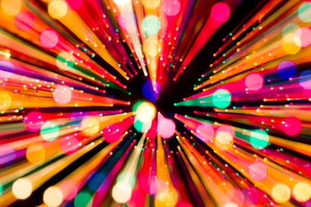 zooming: A streaking and expanding Christmas lights special effect.