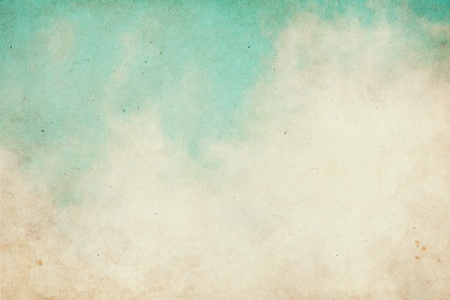 Fog and clouds on a textured vintage paper background with grunge stains.