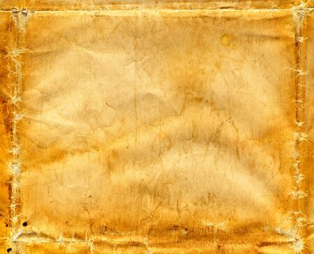 A vintage paper background with folds, wrinkles and creases.
