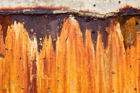 corroded: A heavily stained and corroded cement wall.