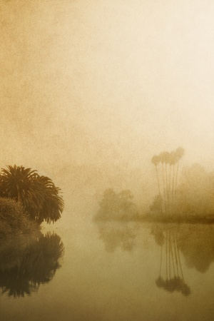 water's: An estuary in fog with a vintage look and paper textures. Stock Photo