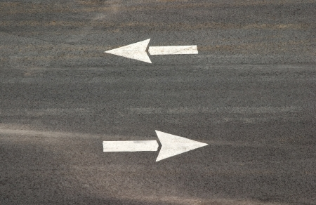 Two directional parking lot arrows.  photo