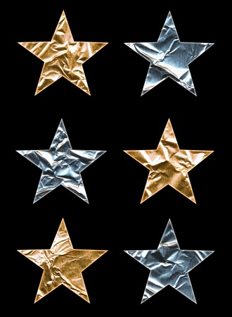tin: Six large gold and silver stars on black