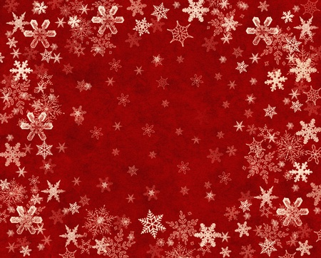 Snowflakes on a textured red paper background. photo