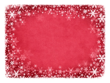 Snowflakes on a textured red cloth background. photo