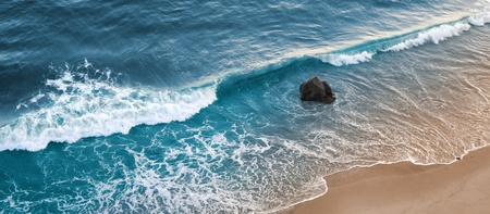 A wave breaking on a beach in central California.
