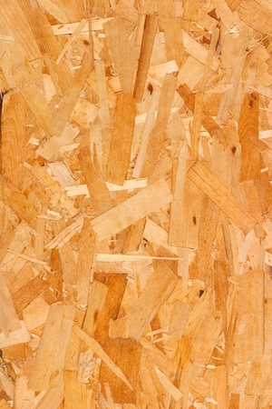 A close-up of mutli-layered plywood siding.