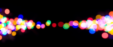 disco lights: Christmas lights with a bokeh effect on a black, panoramic background. Stock Photo