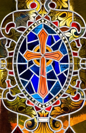 A stained glass rendition of a cross. photo