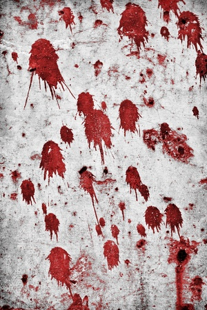 horrors: Red splatter on a grungy rock wall. Stock Photo