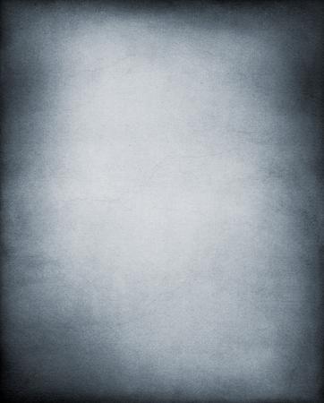Een uitstekende, geweven papier achtergrond in koele zwart-wit tinten.