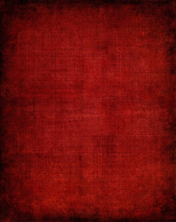 fabric texture: Old vintage red cloth with a screen pattern and dark vignette. Stock Photo