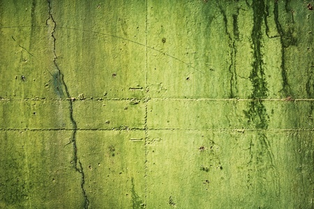 degraded: An old, green cement wall with a glowing center. Stock Photo