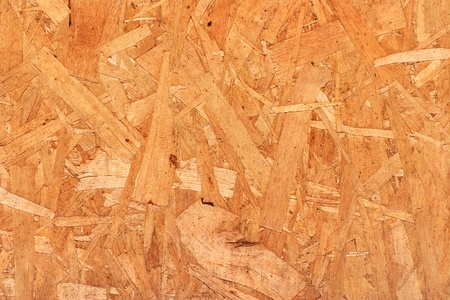 A close-up of mutli-layered plywood siding.