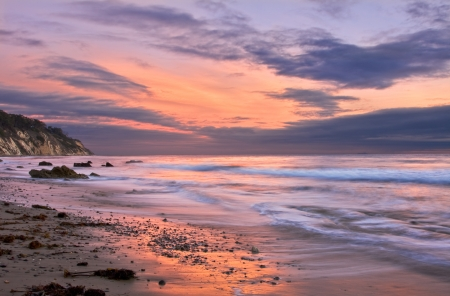 An ocean sunset at low tide in Santa Barbara, California.