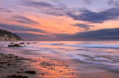 shoreline: An ocean sunset at low tide in Santa Barbara, California.